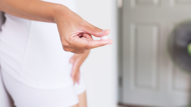 Woman Finger Holding With Leucorrhoea And Pain In Abdomen Or Discharge With Foul Smell